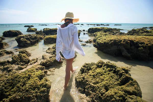 Sun Hat Photograph - A Woman Tourist Enjoys The Sunshine On by Sean White / Design Pics