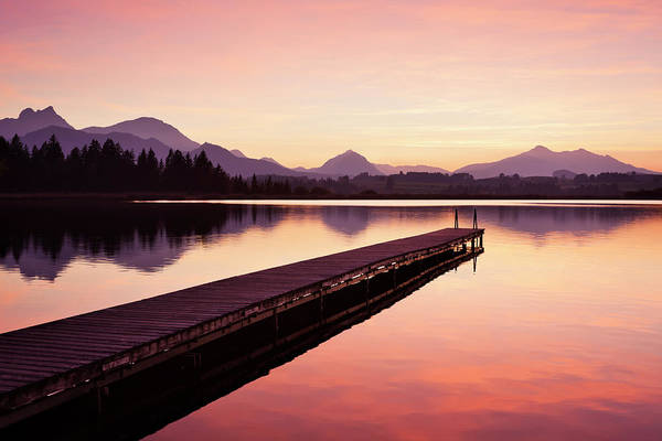 Jetty Photograph - A Wooden Jetty On Lake Hopfensee After by Jorg Greuel