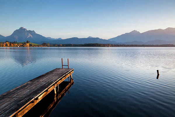 Jetty Photograph - A Wooden Jetty On Lake Hopfensee At by Jorg Greuel