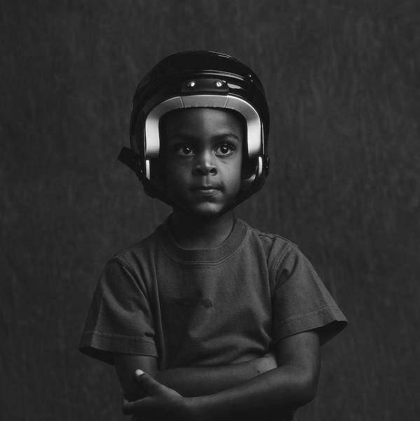 Photograph - A Young Boy 4-6 Wearing A Football by Stockbyte