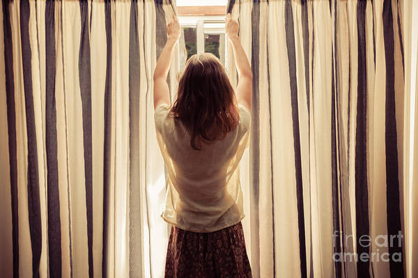 Caucasian Wall Art - Photograph - A Young Woman Is Opening The Curtains by Lolostock