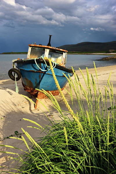 Seaweed Photograph - Abandoned Fishing Boat On Beach Under by Simon Butterworth