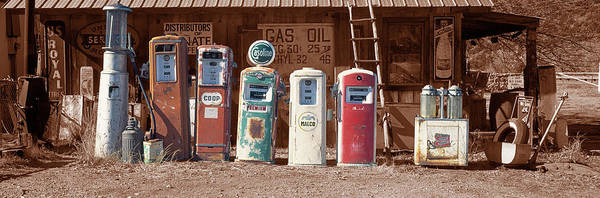 Wall Art - Photograph - Abandoned Fuel Pumps In A Row by Panoramic Images