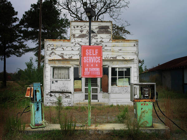 Flammable Wall Art - Photograph - Abandoned Petrol Station At Dusk by Christian Adams