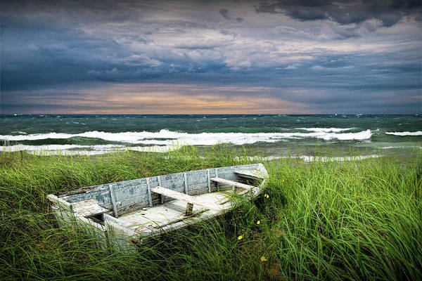 Photograph - Abandoned Row Boat Along The Shoreline At Sunset by Randall Nyhof