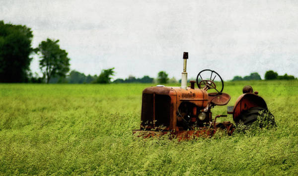 Photograph - Abandoned Tractor by Garvin Hunter