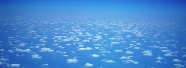 Wall Art - Photograph - Above The Clouds From An Airplane by Myloupe/uig