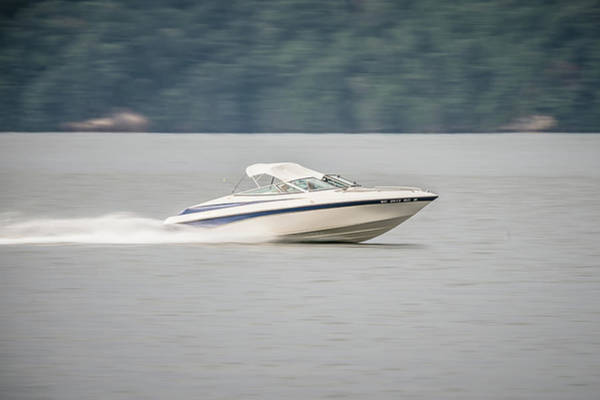 Photograph - Abstract Blur Of Nature And Fast Moving Boat On Lake by Alex Grichenko