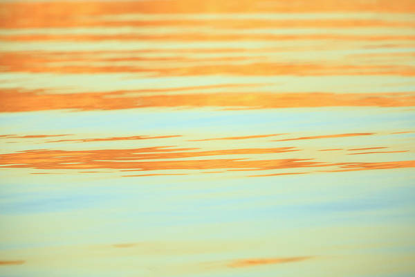 Wall Art - Photograph - Abstract Of Water Ripples In Orange by Stuart Westmorland