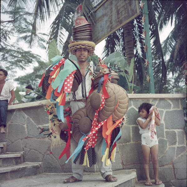 Straw Hat Photograph - Acapulco Hat Seller by Slim Aarons