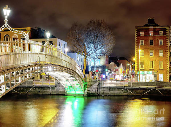 Wall Art - Photograph - Across The Ha'penny Bridge At Night In Dublin by John Rizzuto
