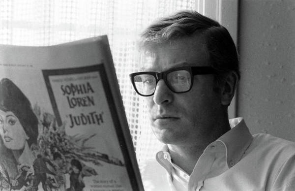 Newspaper Photograph - Actor Michael Caine Reading A Newspaper by Bill Ray