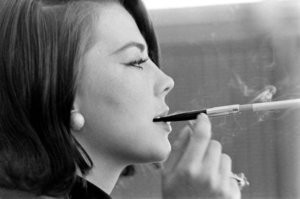 Meeting Photograph - Actor Natalie Wood Lights Up A by John Dominis