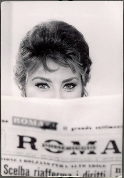 Newspaper Photograph - Actress Sophia Loren Impishly Peering by Alfred Eisenstaedt