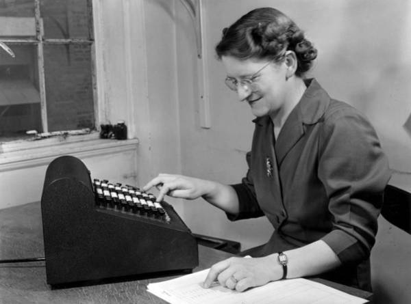 Businesswoman Photograph - Adding Machine by Hulton Collection