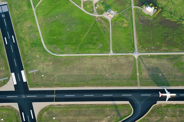 Parallels Wall Art - Photograph - Aerial View Of Airport Runway by Simon Casson