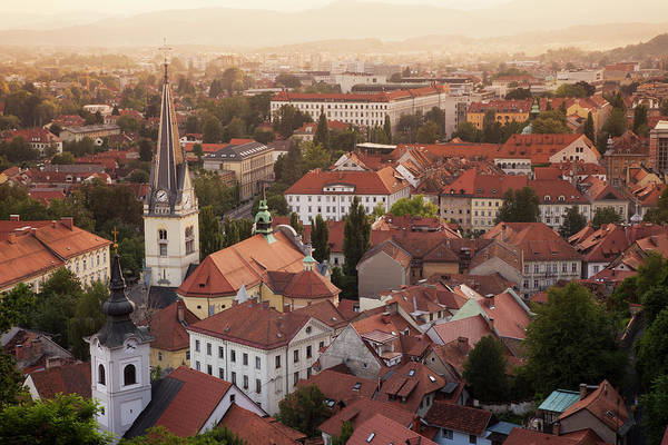 Ljubljana Wall Art - Photograph - Aerial View Of Church And Rooftops by Cultura Rf/lost Horizon Images