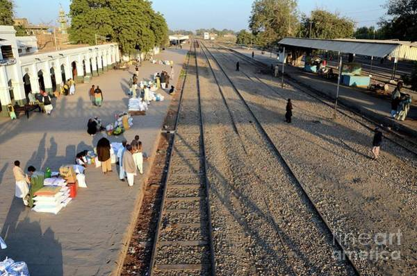 Wall Art - Photograph - Aerial View Of Travelers And Traders With Goods Mirpurkhas Railway Station Platform Sindh Pakistan by Imran Ahmed