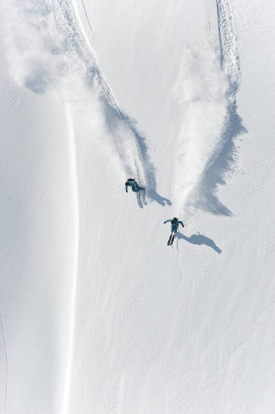 Crash Helmet Photograph - Aerial View Of Two Skiers Skiing by Creativaimage