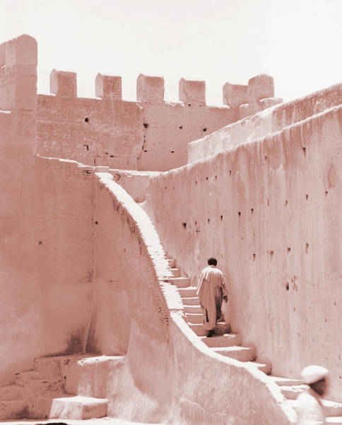 Casbah Photograph - Africa, Morocco, Man Walking Up Stairs by Pieter Estersohn