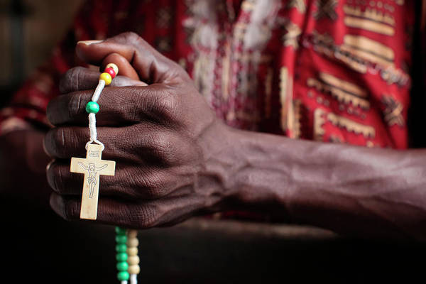 Wall Art - Photograph - African Man Praying The Rosary by Uig