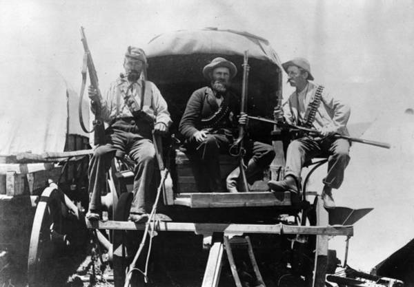 Rifle Photograph - Afrikaners On Wagon by Henry Guttmann Collection