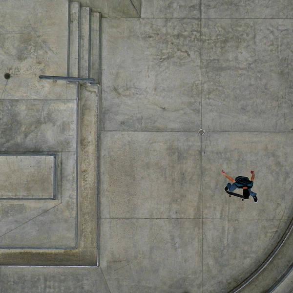 Skateboard Photograph - Airborne Boy On Skateboard by Simon Scott