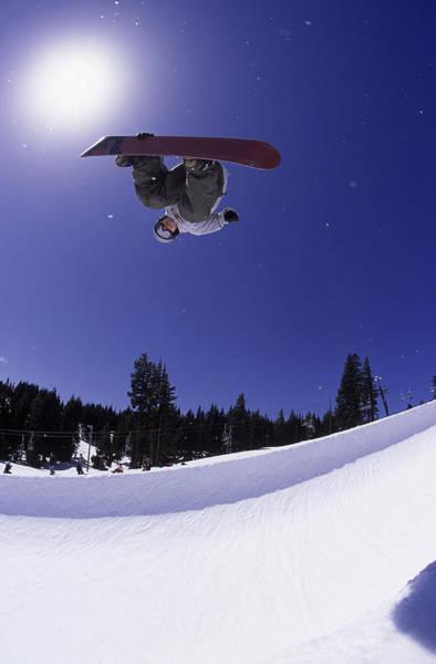 Sport Fish Photograph - Airborne Snowboarder In Half Pipe by Kurt Olesek