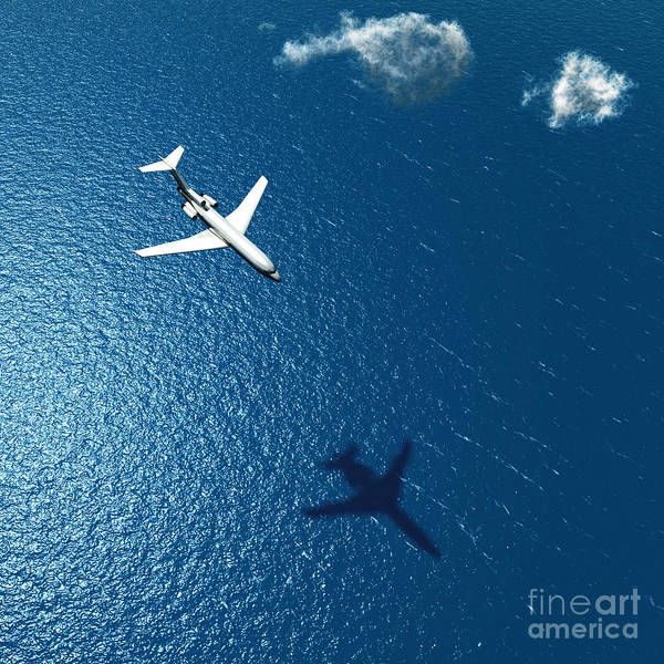 Wall Art - Photograph - Airplane Flies Over A Sea by Photobank Gallery