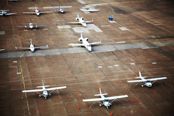 Stationary Photograph - Airplanes On Tarmac by Thomas Northcut