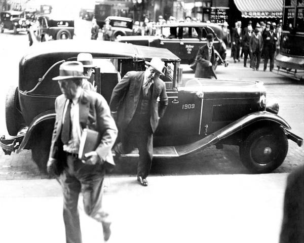 Illinois Photograph - Al Capone Leaving A Taxi Outside The by New York Daily News Archive