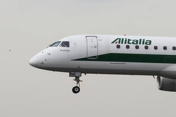 Wall Art - Photograph - Alitalia Embraer 190 And Bird  by David Pyatt