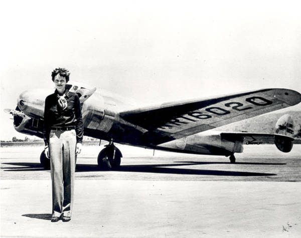 Flying Photograph - Amelia Earhart Standing In Front Of The by Science Source