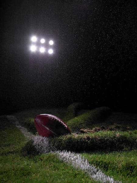 Team Sport Photograph - Amercian Football On Folded Lawn On by Phil Ashley