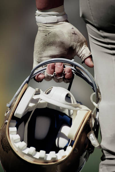 Football Helmet Photograph - American Football Player Carrying Helmet by David Madison