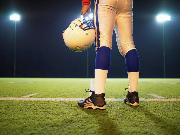 Football Helmet Photograph - American Football Player Holding by Ryan Mcvay