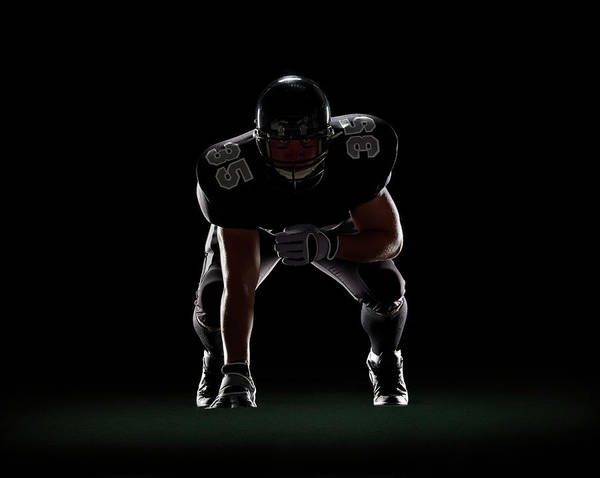 Football Helmet Photograph - American Football Player In 3-point by Lewis Mulatero