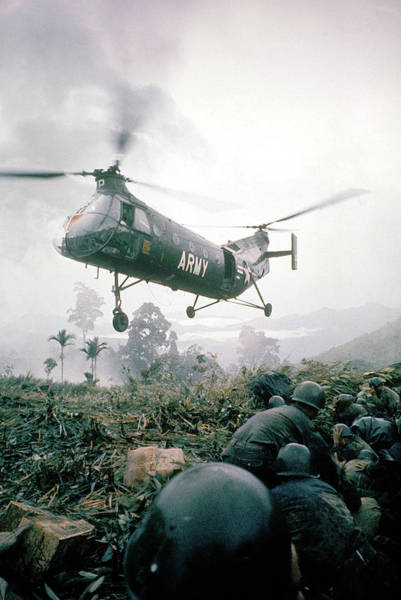 Wall Art - Photograph - American Helicopter H-21 Hovering Above by Larry Burrows