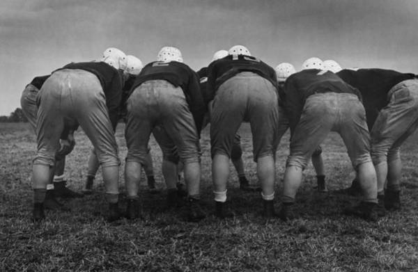 Football Helmet Photograph - American Huddle by Kurt Hutton