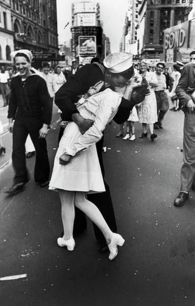 Wall Art - Photograph - American Sailor Kisses White-uniformed by Alfred Eisenstaedt