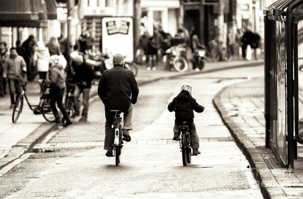 Photograph - Amsterdam Father And Son Bike Riding by John Rizzuto