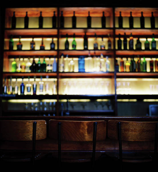 Bar Counter Photograph - An Array Of Bottles Kept In Shelves At by George Doyle