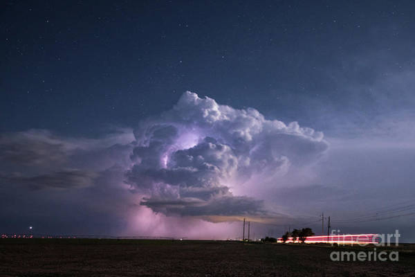 Photograph - An Evening Lightening Storm Blows Over Farmlands. by Keith Ladzinski