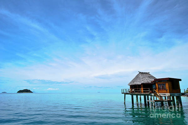 Photograph - An Exclusive Resort Bungalow Over A Calm Tropical Sea. by Jason Edwards