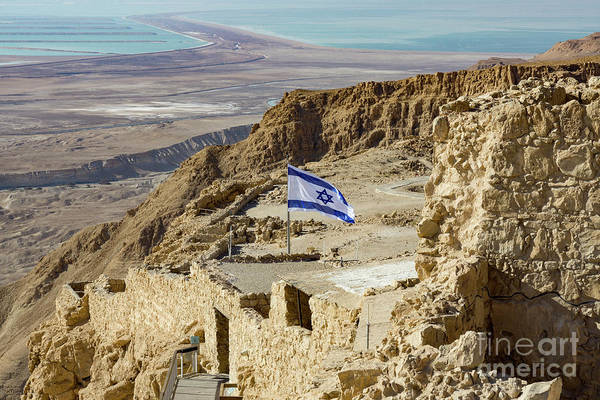 Photograph - An Israeli Flag Flies Near The Entrance To The Top Of Masada In  by William Kuta