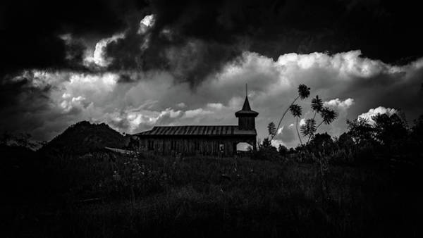 Photograph - Ancient Wooden Church With Storm Clouds by Chris Lord