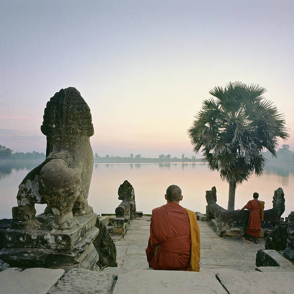 Photograph - Angkor Wat, Buddhist Monks At Waters by Martin Puddy