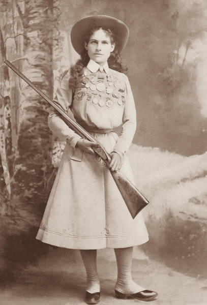 Wall Art - Photograph - Annie Oakley Holding A Rifle - 1899 by War Is Hell Store