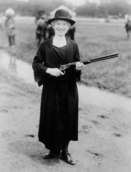 Wall Art - Photograph - Annie Oakley Holding Rifle - 1922 by War Is Hell Store