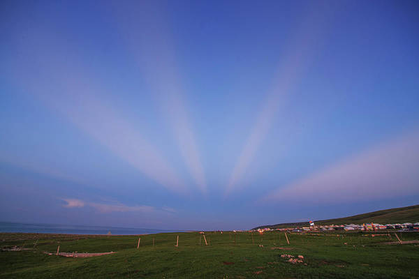 Photograph - Anticrepuscular Rays Above Qinghai Lak by Jeff Dai